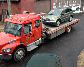 Auto haul on flatbed customers access towing in CT 24 hour per day