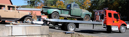 Specialty antique car flatbed hauling service in CT using Towstar